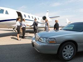Photo of executives meeting at an airport