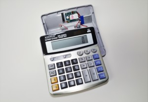 Desk calculator with microphone and GSM transmitter.